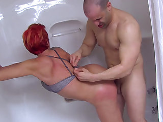 Shower sex with a redhead MILF