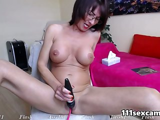 Big tits MILF camgirl masturbating and squirting on webcam