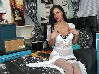 Wearing white stuff whore Cassie Clarke is happy to tease her wet pussy