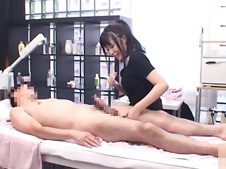 Sexy mature Japanese woman gives a titty fucking