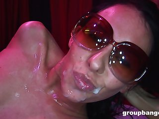 Skinny trendy babe cum covered in a gangbang at the club