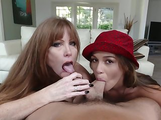 Milf joins a young couple for a BJ threesome
