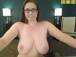 Redhead with enormous hooters - webcam clip