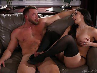 After treating man with footjob sexy Sheena Ryder rides stiff dick