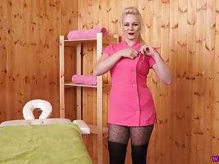 Big tittied and big bottomed blonde Megan shows off her assets on the massage table